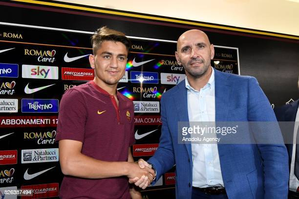 Roma's new Player Cengiz Under shakes hands with Sports director of AS Roma Ramon Rodriguez Verdejo Monchi during a press conference at Fulvio...