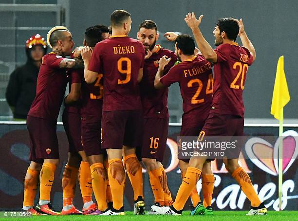 AS Roma's player celebrate after scoring during their Serie A football match AS Roma vs Palermo at the Olympic stadium in Rome on October 23 2016 /...