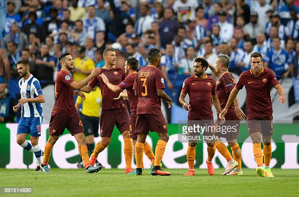 AS Roma's players celebrate an own goal scored by Porto's Brazilian defender Felipe during the UEFA Champions League first leg play off football...