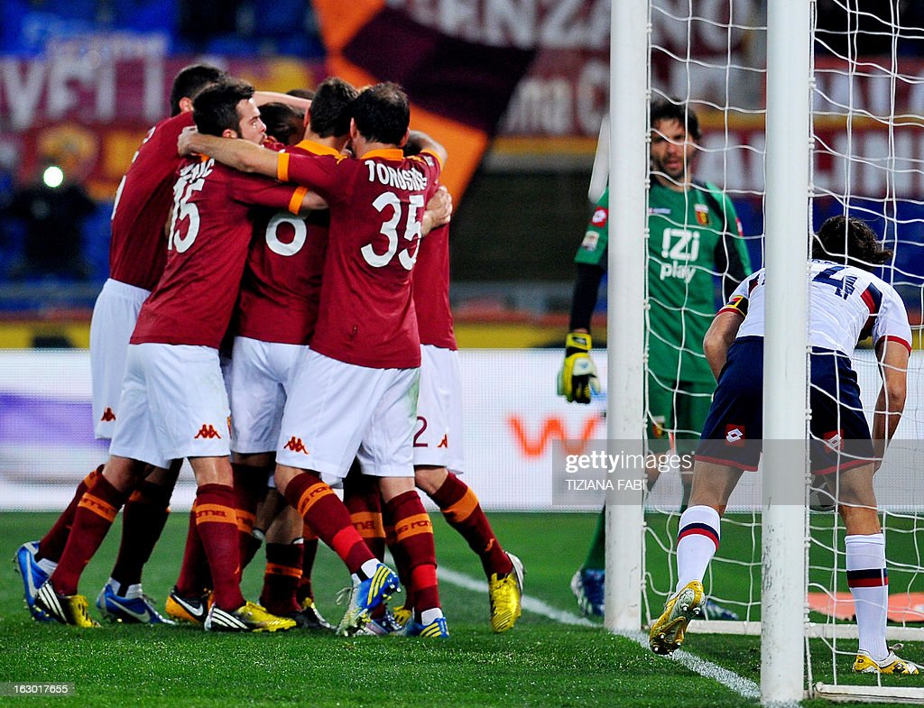 AS Roma's players celebrate asfter their forward Francesco Totti (C) scored during the Italian Serie A football match AS Romsa vs Genoa at Olympic Stadium on March 3, 2013 in Rome.