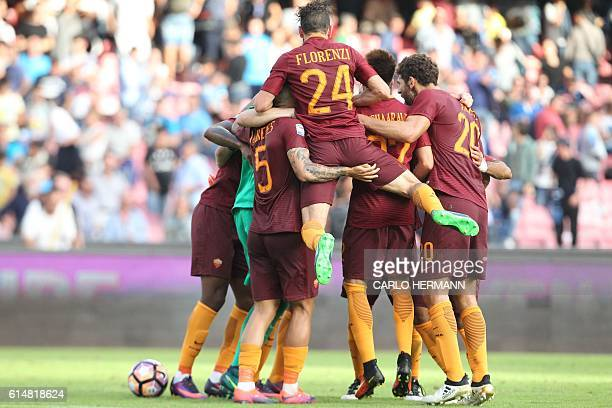 Roma's players celebrate at the end of the Italian Serie A football match SSC Napoli vs AS Roma on October 15 2016 at the San Paolo stadium in Naples...