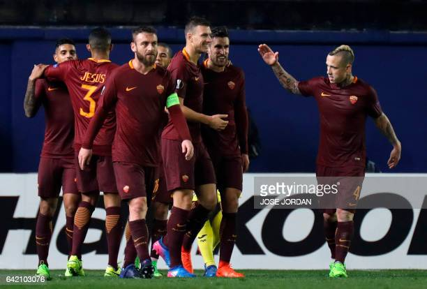 Roma's players celebrate their fourth goal during the Europa League round of 32 first leg football match Villarreal CF vs AS Roma at El Ceramica...