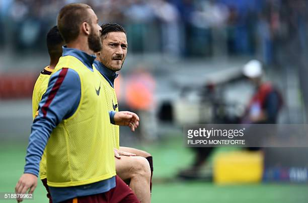Roma's players Francesco Totti and Daniele De Rossi warm up during the Italian Serie A football match Lazio vs AS Roma at the Olympic stadium in Rome...