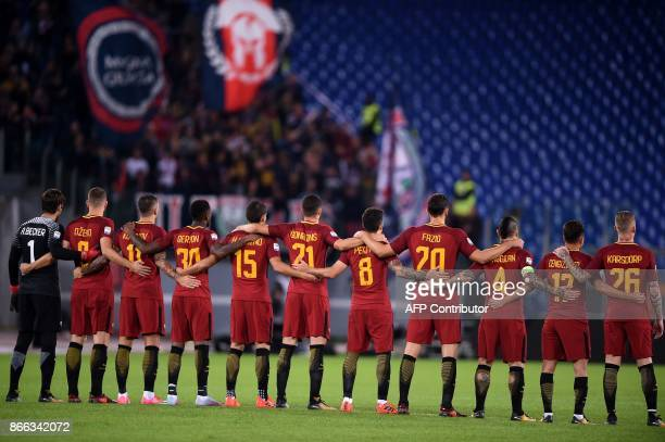 AS Roma's players listen to a speaker reading a passage from the diary of holocaust victim Anne Frank before the Italian Serie A football match AS...