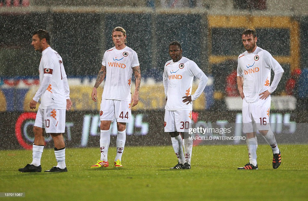 AS Roma's players react as a referee suspends an Italian Serie A football match against Catania due to heavy rain on January 14 2012 at the Massimino...