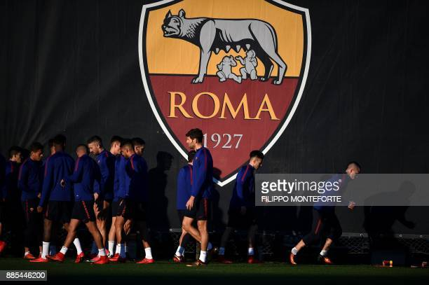 AS Roma's players take part in a training session on the eve of the UEFA Champions League football match AS Roma vs Qarabag on December 4 2017 at...