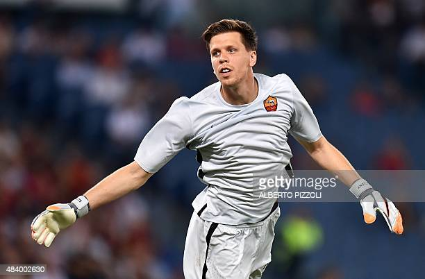 AS Roma's Polish goalkeeper Wojciech Szczesny gestures during a friendly football match between AS Roma and Sevilla on August 14 2015 at the Olympic...