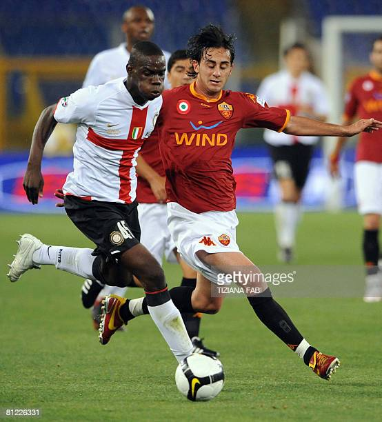 AS Roma's Roberto Aquilani vies with Inter Milan's Mario Balotelli during the final of the Coppa Italia football match at Olympic stadium in Rome on...