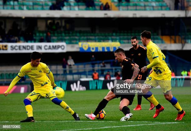 Roma's Serbian defender Aleksandar Kolarov vies with Chievo's players during the Italian Serie A football match between AC Chievo and AS Roma at the...