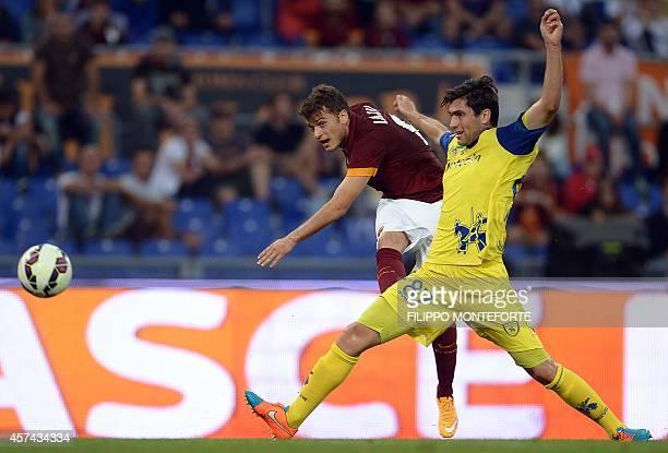AS Roma's Serbian forward Adem Ljajic kicks to score during the Italian Serie A football match Roma vs Chievo on October 18 2014 at the Olympic...