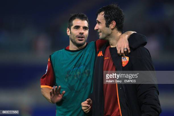 Roma's Simone Perrotta and Mirko Vucinic celebrate victory after the final whistle