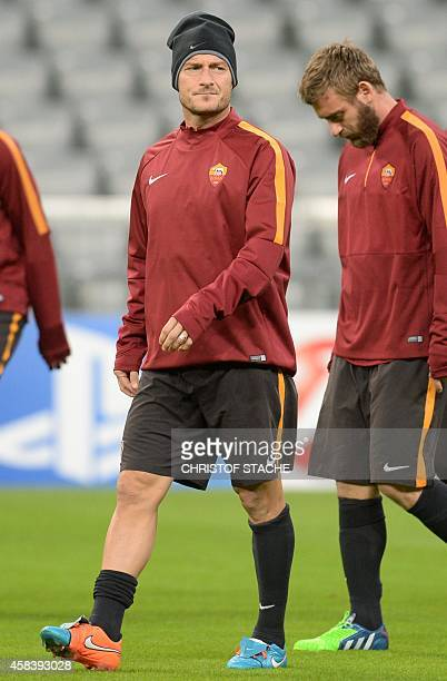 Roma's striker Francesco Totti and midfielder Daniele de Rossi walk during the final team training on the eve of the UEFA Champions League Group E...
