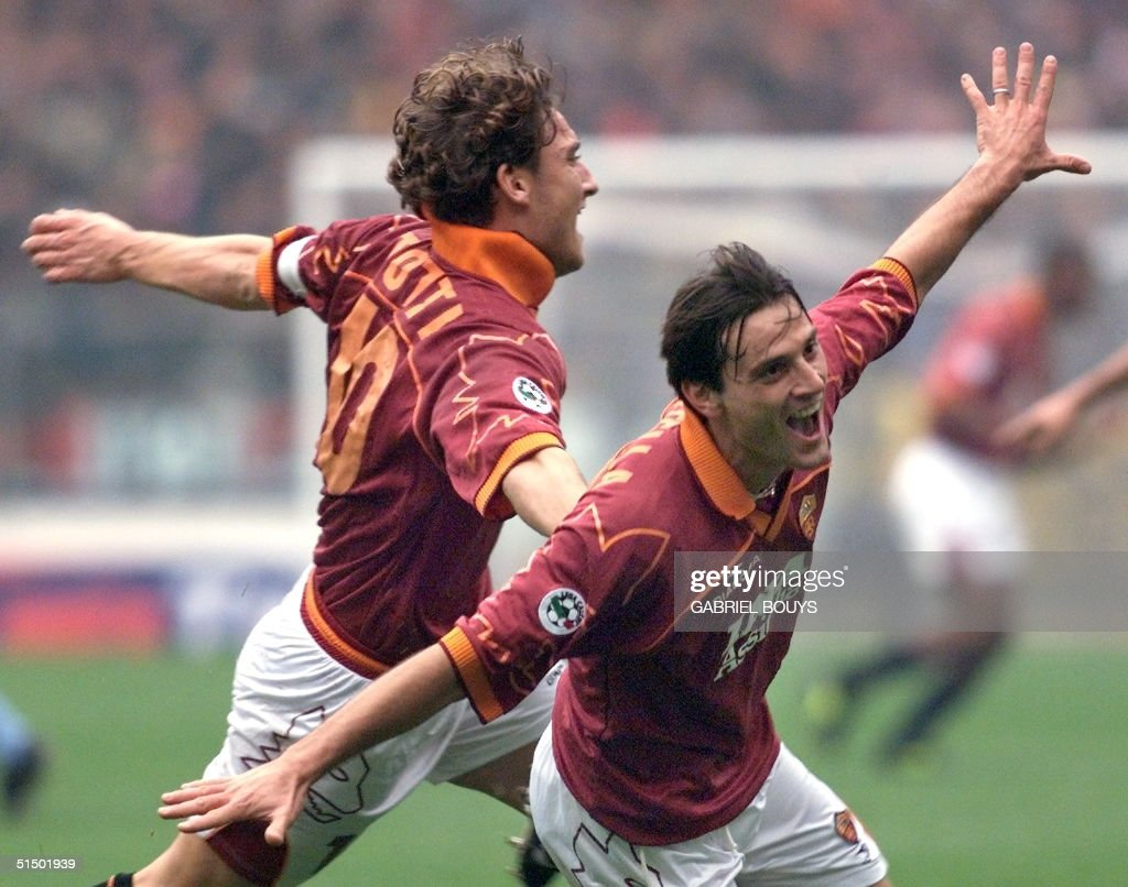 Roma's striker Vincenzo Montella jubilates with his captain Francesco Totti after scoring his second goal 21 November 1999 during the derby AS...