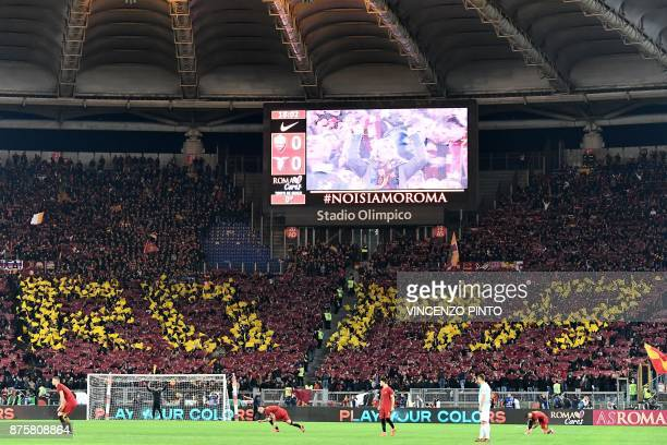 AS Roma's supporters cheer during the Italian Serie A football match AS Roma vs Lazio on November 18 2017 at the Olympic stadium in Rome / AFP PHOTO...