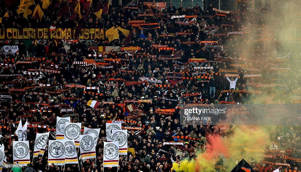 AS Roma's supporters cheer their team during the Italian Serie A football match AS Roma vs Inter on January 20, 2012 at the Olympic stadium in Rome. AFP PHOTO / TIZIANA FABI