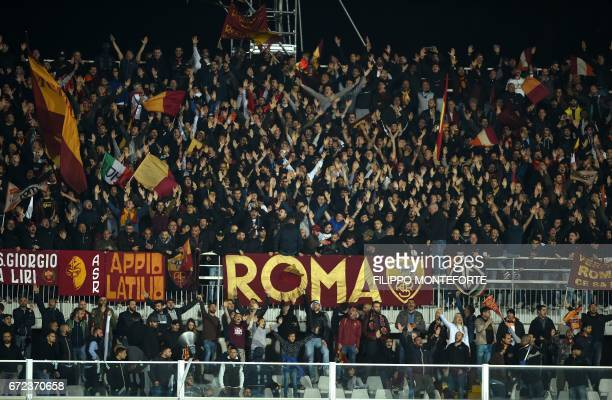 Roma's supporters cheer their team during the Italian Serie A football match Pascara vs Roma at the Adriatico Stadium in Pescara on April 24 2017 /...
