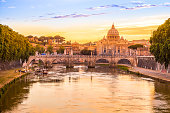 Rome at Sunset with San Pietro basilica, Sant'Angelo bridge and Tevere river in Roma, Italy