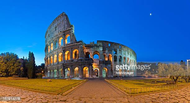 Rome Coliseum ancient Roman amphitheatre illuminated piazza panorama Italy