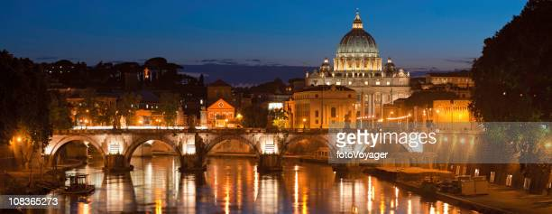 Rome illuminated dusk over River Tiber St Peters Vatican Italy