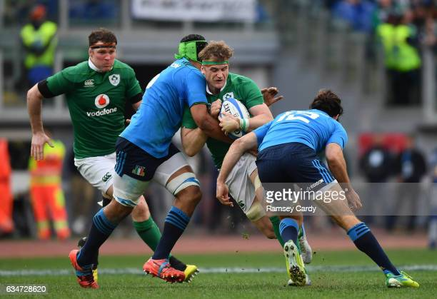 Rome Italy 11 February 2017 Jamie Heaslip of Ireland is tackled by Andries van Schalkwyk left and Luke McLean of Italy during the RBS Six Nations...