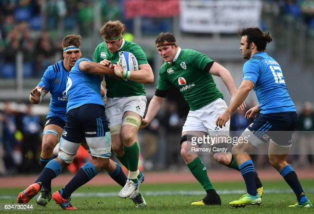 Rome Italy 11 February 2017 Jamie Heaslip of Ireland is tackled by Andries van Schalkwyk of Italy during the RBS Six Nations Rugby Championship match...