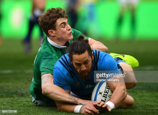 Rome Italy 11 February 2017 Michele Campagnaro of Italy is tackled by Garry Ringrose of Ireland during the RBS Six Nations Rugby Championship match...