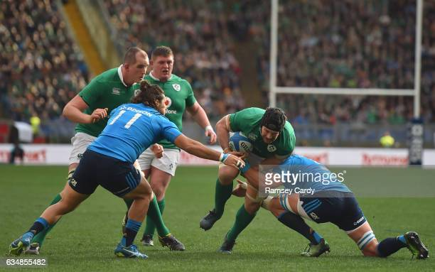 Rome Italy 11 February 2017 Sean O'Brien of Ireland is tackled by Giovanbattista Venditti left and Andries van Schalkwyk of Italy during the RBS Six...