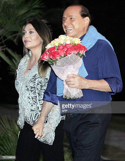 A File picture of Italian Prime Minister Silvio Berlusconi with his wife Veronica during their meeting at Putin's residence in the Russian Black Sea...