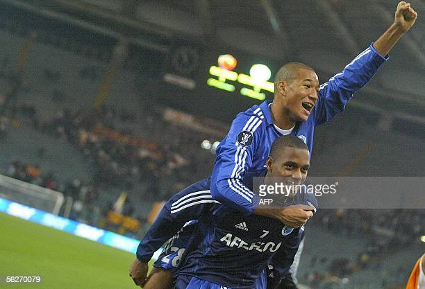 Alexander Farnerud and Habib Bellaid of RC Strasbourg jubilate after a draw against AS Roma on Group E UEFA Cup football match 24 November 2005 in...