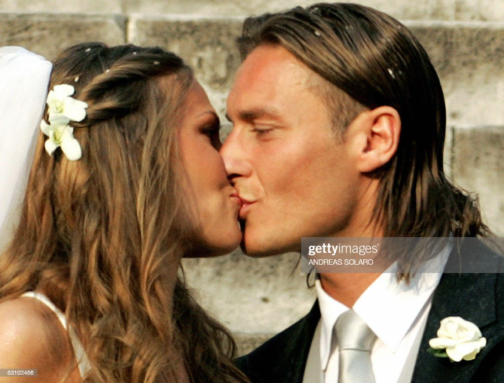 AS Roma captain Francesco Totti kisses his wife Italian TV star Hilary Blasi after their wedding 19 June 2005 in Rome AFP PHOTO/Andreas SOLARO