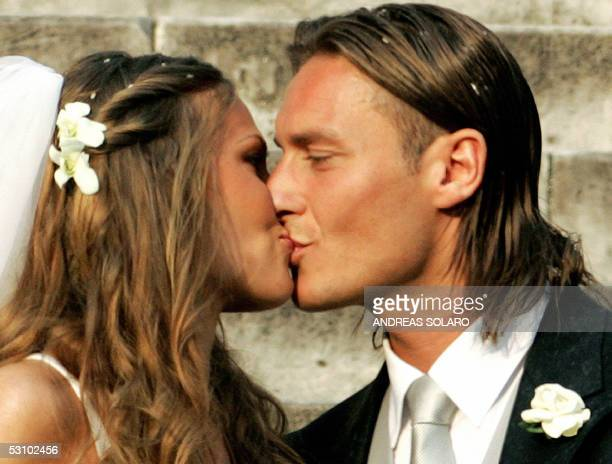 AS Roma captain Francesco Totti kisses his wife Italian TV star Hilary Blasi after their wedding 19 June 2005 in Rome AFP PHOTO/Andreas SOLARO