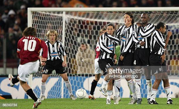 AS Roma captain Francesco Totti shoots a free kick against Juventus during their Serie A football match at Rome's Olympic stadium 19 November 2005...