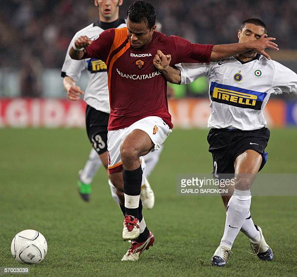 AS Roma's midfielder Alessandro Amantino Mancini of Brazil vies with Inter Milan's defender Ivan Ramiro Cordoba of Colombia during their Italian...