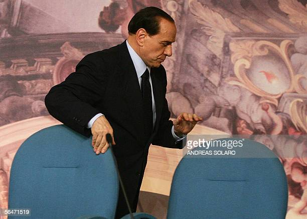 Italian Prime Minister Silvio Berlusconi leaves the news conference in Rome 20 December 2005 following a cabinet meeting to discuss the banking...