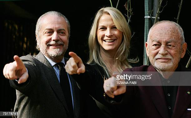 Italian producers Dino De Laurentiis his wife Martha Schumacher and his son Aurelio pose during the photocall of 'Hannibal Rising' directed by...