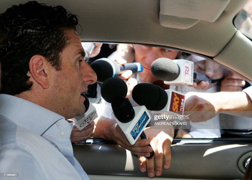 Italian referee Massimo De Santis leaves Rome's Olympic stadium where a soccer league trial is to take place 04 July 2006 over the Italian...