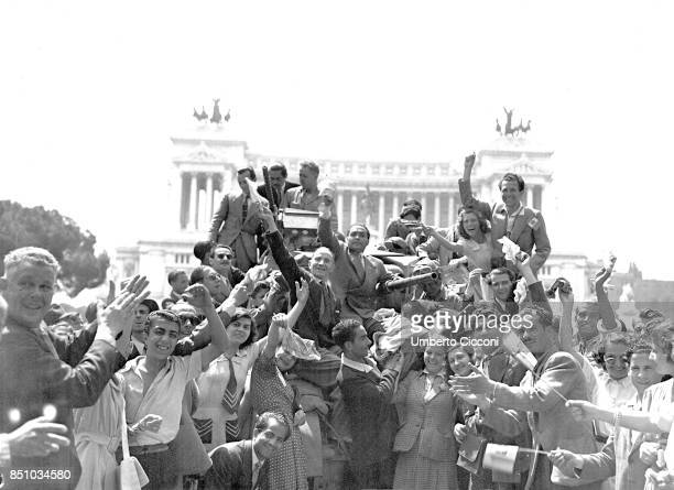 Rome Italy June 4 1944 Liberation of Rome by the US Army troops WWII the citizens give a warm welcome to the Allied climbing a tank Their enthusiasm...