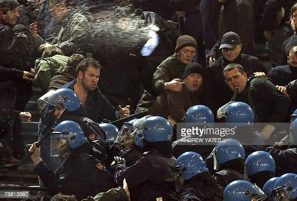 Manchester United fans face riot police during the quarter final UEFA champions league football match Manchester United vs AS Roma 04 April 2007 at...