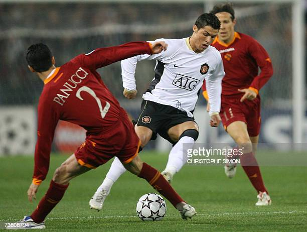 Manchester's forward Cristiano Ronaldo of Portugal dreebles between Roma's Christian Panucci and Rodrigo Taddei of Brazil during their Champions...