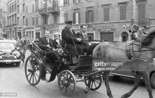 Rome Italy March 16 1957 President Richard Nixon and his wife Pat Nixon on a hackney coach to Piazza di Spagna in Rome followed by photographers and...