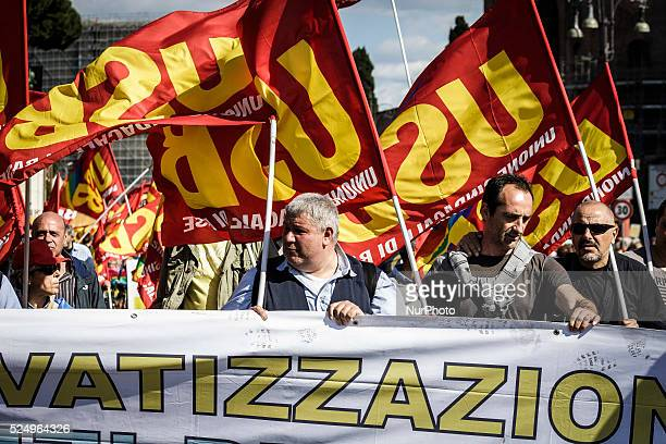 Protesters wave flags and hold banners during a nationwide demonstration against the privatization of the commons and the austerity policies to deal...