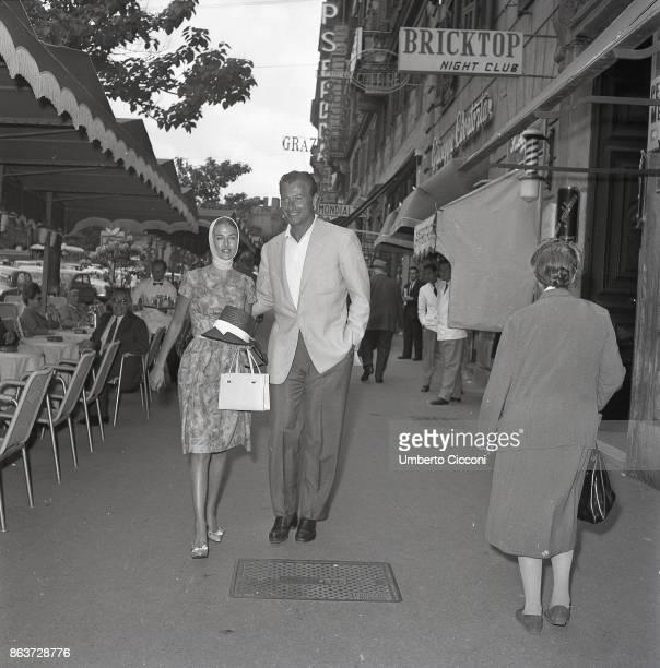 Rome Italy May 1962 Alexander Crichlow aka Lex Barker and his wife Irene Labhart in Via Veneto walking