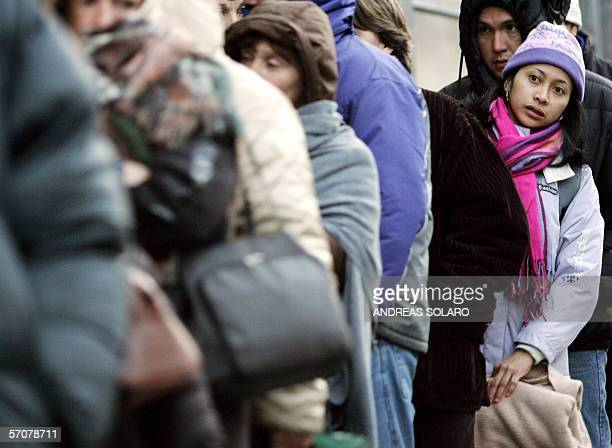 NonEuropean Union foreigners queue outside a post office before its opening to fill an application form for a work permit early 14 March 2006 in Rome...