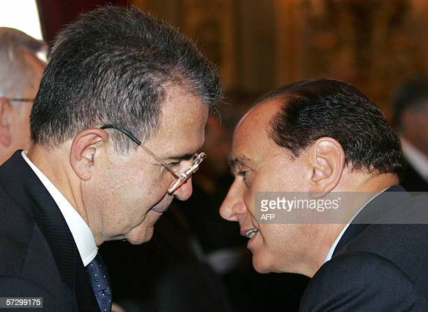 Picture taken 24 June 2005 of Italian Prime Minister Silvio Berlusconi talking with head of the leftwing opposition Romano Prodi at the Quirinale...
