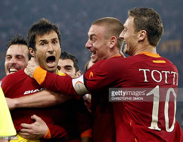 Roma's forward Mirko Vucinic of Montenegro celebrates with his teammate Francesco Totti and Daniele De Rossi after scoring the second goal against...