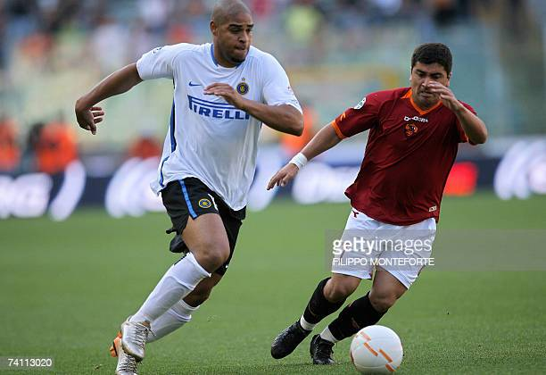 Roma's midfielder David Pizarro fights for the ball with Inter Milan's forward Leite Ribeiro Adriano during their Coppa Italia first leg final...
