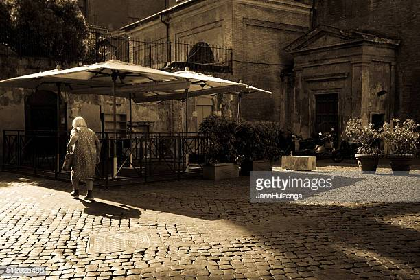 Rome, Italy: Senior Woman on Beautiful Empty Cobbled Piazza (Sepia)