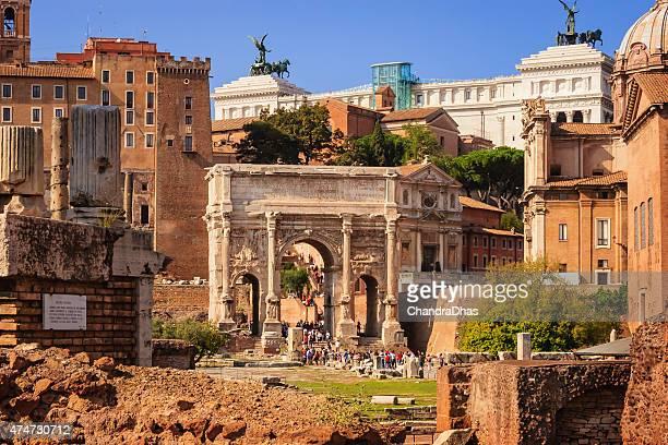 Rome, Italy: Tourists stream through the Arch of Septimius Severus.