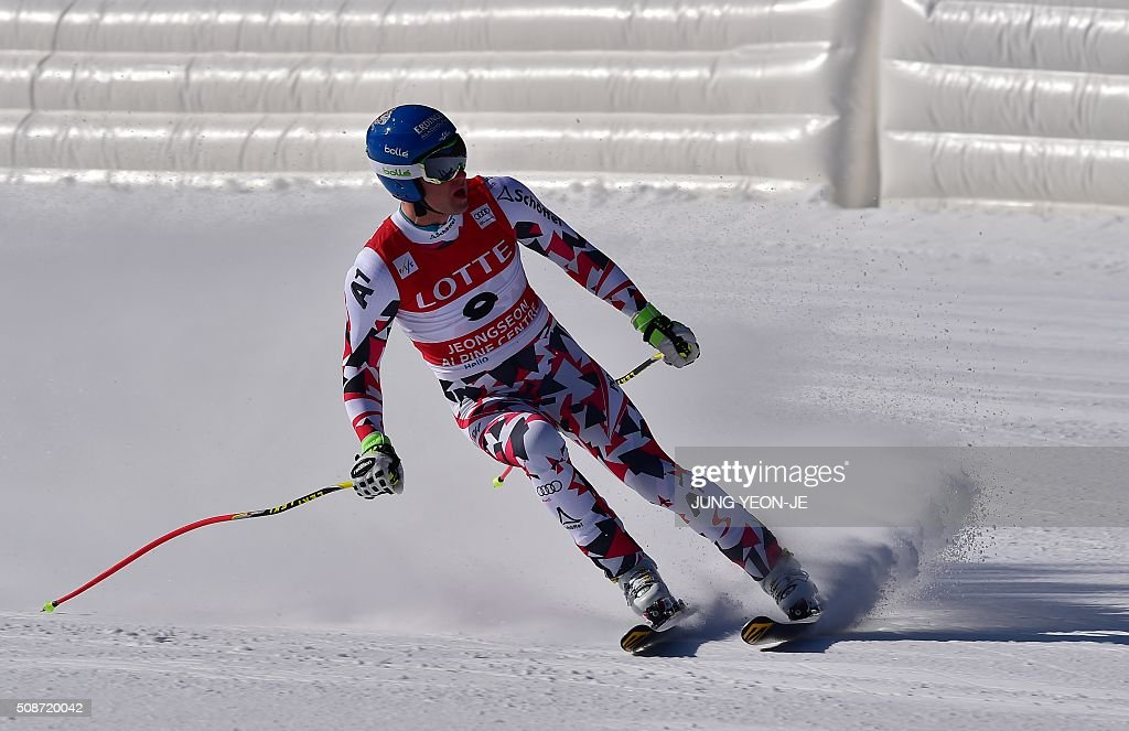 Romed Baumann of Austria arrives at the finish during the 8th men's downhill event of the FIS Alpine Ski World Cup at Jeongseon Alpine Centre in Jeongseon county, some 150km east of Seoul, on February 6, 2016. The FIS Ski Men's World Cup runs from February 6-7 and is the first official test event for the Pyeongchang 2018 Winter Olympics. AFP PHOTO / JUNG YEON-JE / AFP / JUNG YEON-JE