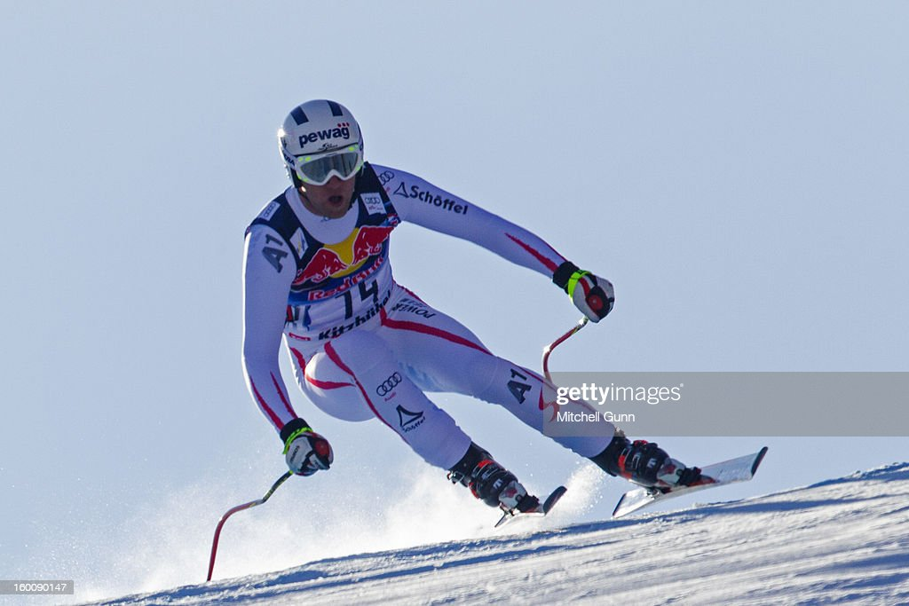 Romed Baumann of Austria races down the Hahnenkamm course during the Audi FIS Alpine Ski World Cup Downhill on January 26, 2013 in Kitzbuhel, Austria,